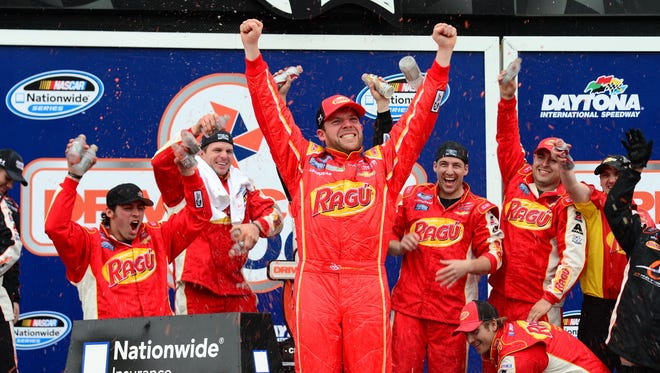 Regan Smith celebrates winning the DRIVE4COPD 300 Nationwide Series race Saturday at Daytona International Speedway.