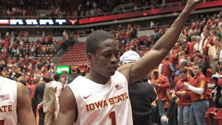 Iowa State's Tyrus McGee, left, and Bubu Palo, right, celebrate 77-71 win over Texas  at Hilton Coliseum on Jan. 4, 2012.