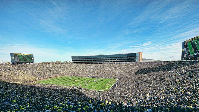 Seven high school football games will take place Michigan Stadium in August.