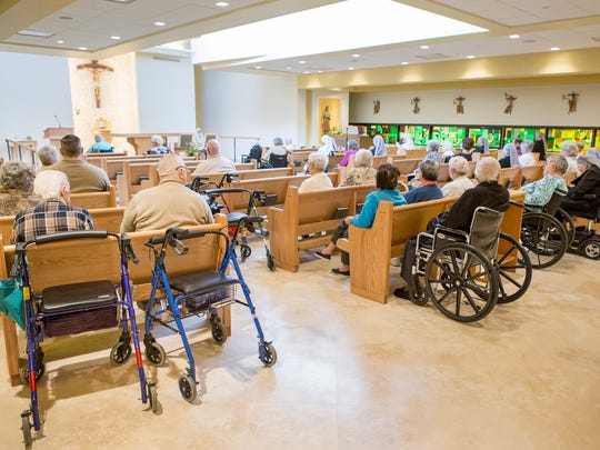Residents of the Little Sisters of the Poor nursing home attend a service at the home's chapel in Ogletown on Tuesday afternoon, March 28, 2017.