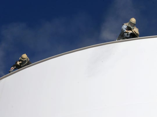Construction personnel in January worked atop the Ventanas elevated water storage tank in East El Paso. Adding water tanks and other water projects are reasons that El Paso Water officials are again proposing a rate increase for its customers.