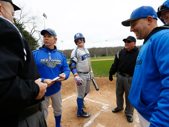Metuchen head coach Leo Danik and team captain Michael Lapczynski review grounds rules before an April 17 game against Middlesex.