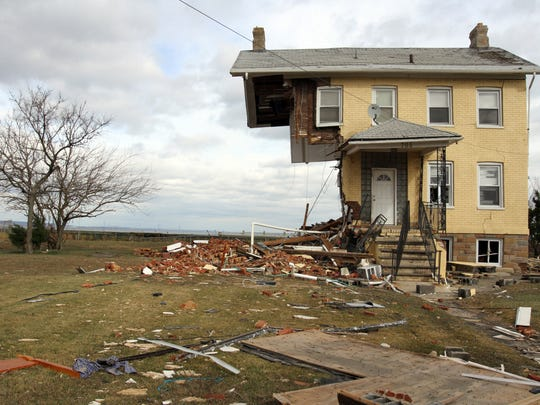 A Front Street home sheared in half in UNion Beach Thursday November 1.  Staff photo Tanya Breen/ASBURY PARK PRESS