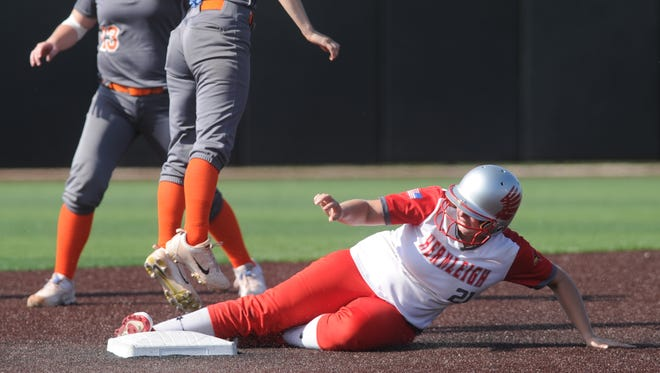 Hermleigh's Lillyan Digby steals second base as Rotan shortstop Jackie Dunn (3) leaps for a high throw in the fifth inning. Hermleigh won the one-game Region I-1A semifinal playoff game 17-8 Saturday at ACU's Wells Field.