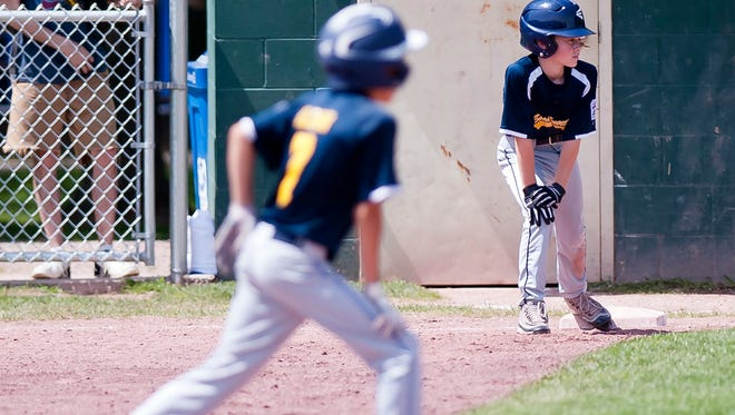 Essex Junction runners are poised at first and second base during Saturday's 11-12-year-old Little League baseball state championship game in Essex.