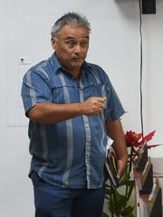 "Manenggon Memorial Foundation President Willy Flores encourages Guam mayors to attend and support his upcoming ""Christmases not Forgotten"" event during a meeting at the Mayors' Council of Guam conference room in Hagåtña on Dec. 6, 2017."