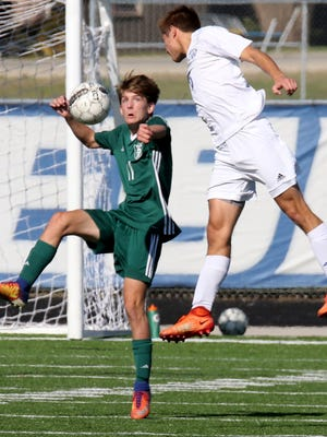 Wauwatosa West's Tyler Piek and Wauwatosa West's Tucker Remmers go up to battle for the ball at Waukesha on Oct. 21.