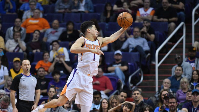 Feb 2, 2018; Phoenix, AZ, USA; Phoenix Suns guard Devin Booker (1) catches a pass against the Utah Jazz during the first half at Talking Stick Resort Arena. Mandatory Credit: Joe Camporeale-USA TODAY Sports