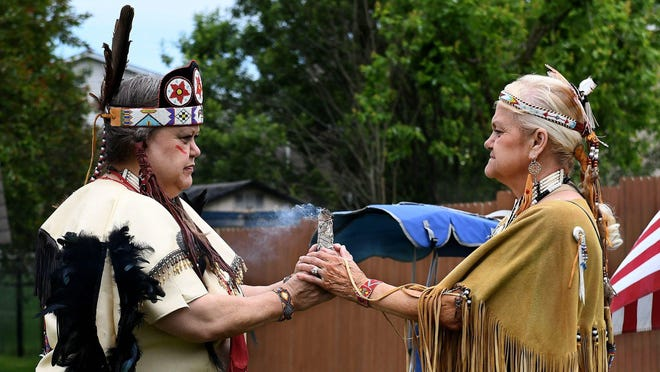 Elizabeth Sowders (left), whose Cherokee name is Morningsun, and her mother Sandra Hensley Huff, whose Cherokee name is Snowbird, begin a Dance of Peace event they hosted June 13 in northwest Massillon. Sowders, 57, had been separated from her mother for nearly her entire life. She reconnected with Huff in 2019.