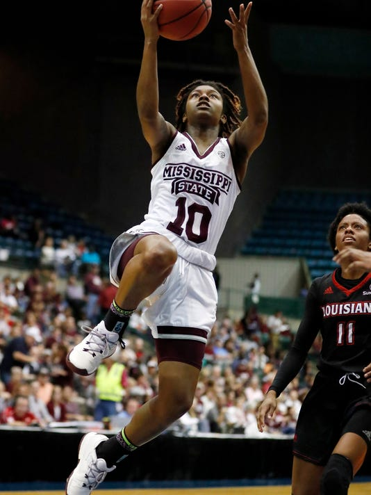Mississippi State guard Jazzmun Holmes (10) leaps towards the basket for a layup attempt while Louisiana Lafayette guard Skyler Goodwin (11) watches during the first half of an NCAA college basketball game in Jackson, Miss., Wednesday, Nov. 29, 2017. (AP Photo/Rogelio V. Solis)