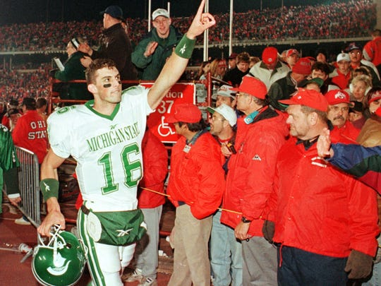 Michigan State quarterback Bill Burke (16) celebrates