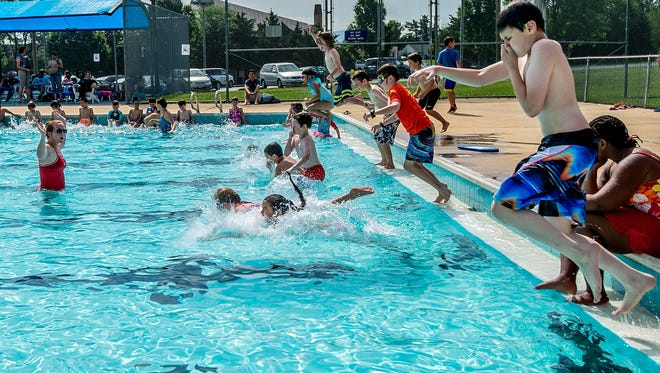 Childern learn how to properly jump into a pool in a lesson taught by Noelle Burgess, left,  during Westover Poolís attempt to be a part of breaking the Guinness World Record for the worldís largest swim lesson in partnership with Swimming Lessons Save Lives on Thursday, June 18.