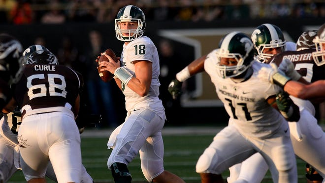 MSU quarterback Connor Cook looks downfield as he readies to pass in the first quarter Friday against Western Michigan. Cook and MSU's offense put up 452 yards against the Broncos, but slowed in the second half as WMU's offense rallied.