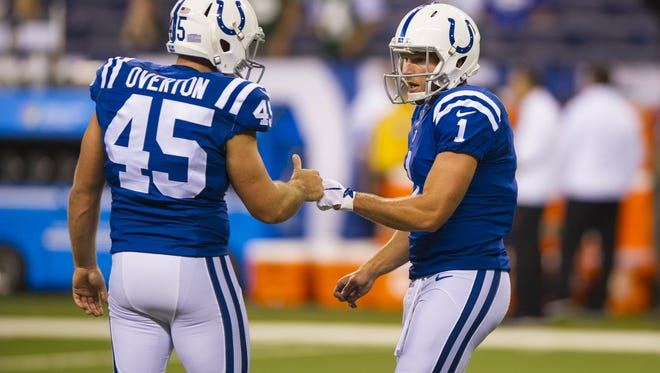Indianapolis Colts punter Pat McAfee (1), right, workout with Indianapolis Colts long snapper Matt Overton (45) during the pre-game warmup of a NFL Monday Night Football game, Monday, September 21, 2015, .