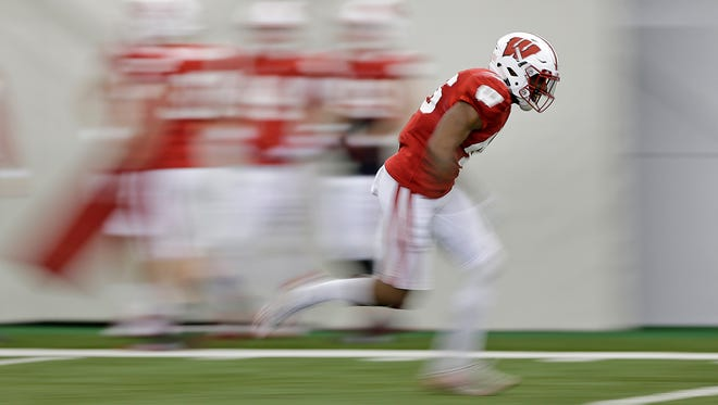 Wisconsin Badgers linebacker Ty DeForest (46) runs drills during practice inside the Don Hutson Center in Ashwaubenon on Saturday, April 2, 2016.