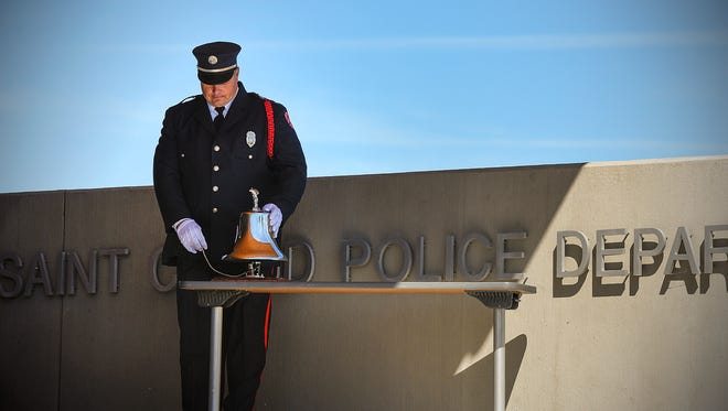 St. Cloud Fire Department Capt. Glen Koshiol silenced the bell after ringing it for the last time then stood in silence during A Day to Remember on Sunday, Sept. 11, 2016, at the St. Cloud Police Department.  The ceremony marked the 15th anniversary of the 9/11 terror attacks.
