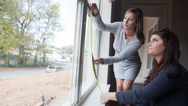 From left, home buyer Jill Molteni and HND Relator Marcia Creecy take window measurements inside Molteni's condominium at The Park at Melrose Heights.