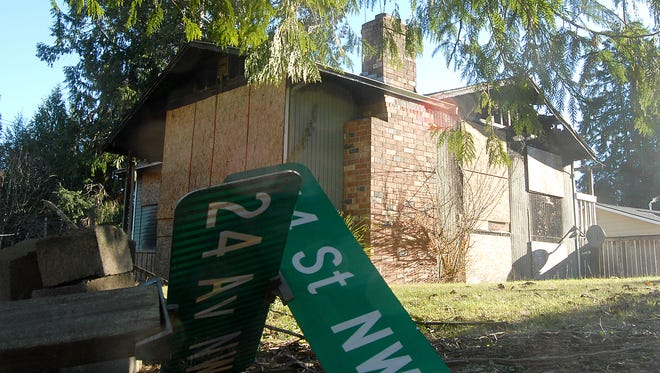 A burned out home at the corner of Reid Drive and 54th Street NW has become an issue for nearby residents, who said the boarded-up home has been an eyesore and health hazard to area children for more than a year. They are looking to county officials for a resolution.