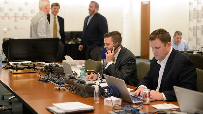 Eliot Wolf (left) and Brian Gutekunst (right) work in the draft room in 2015.