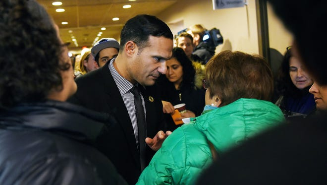 Michigan State University Trustee Brian Mosallam talks with people waiting to get into a town hall meeting that he hosted on Thursday, Feb. 1, 2018, at the Kellogg Center on the MSU campus in East Lansing.
