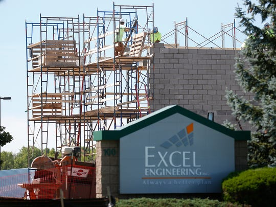 Construction workers build an addition to Excel Engineering at 100 Camelot Drive in Fond du Lac.