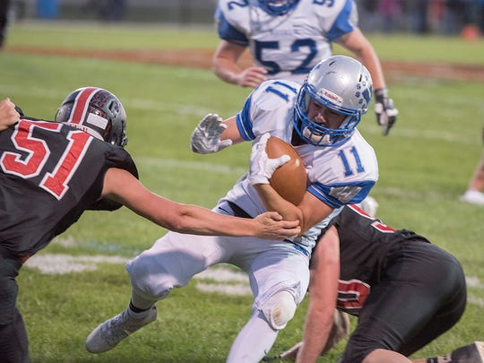 Wynford's Robbie Miller slips by Mohawk's Collin Cordell.