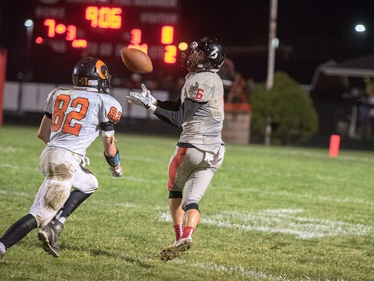 Bucyrus' Gram Dick makes a catch for a big gain.