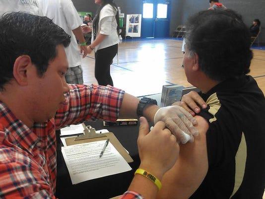 Pacific Islander Health Fair Flu Shot.jpg