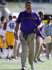 LSU coach Ed Orgeron, tries to get the attention of players during a win over Louisville last year.
