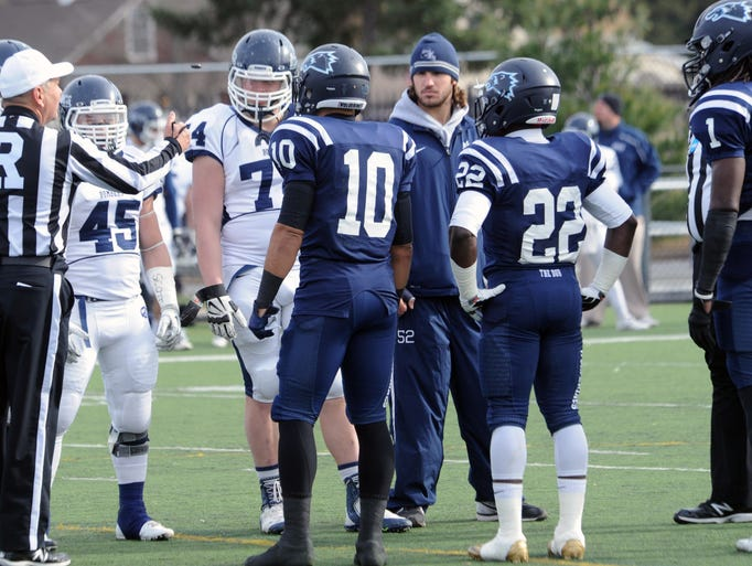 Team captains from Wesley and Ithaca at midfield for coin toss before their Division III tournament game Saturday.