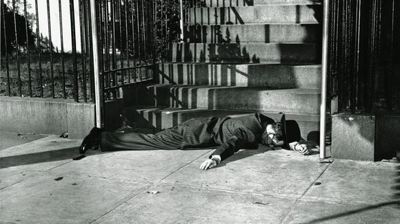 Puerto Rican nationalist Oscar Collazo lies wounded at the base of the steps to Blair House, President Truman's temporary residence in Washington, D.C., after a failed attempt to assassinate Truman Nov. 1, 1950.