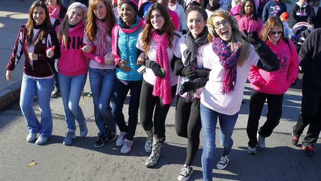 A group of supports hams it up as walkers hit the streets for the American Cancer Society Making Strides Against Breast Cancer walk in Rochester Sunday morning, October 20, 2013.