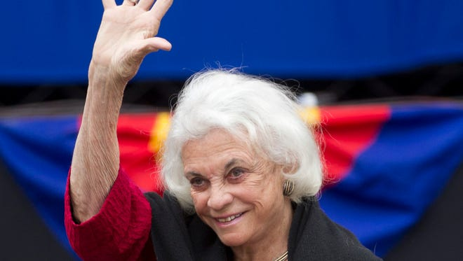 Retired Supreme Court Justice Sandra Day O'Connor waves to the crowd during centennial events at the State Capitol in Arizona on Feb. 14, 2012.