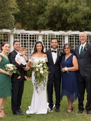Calvin Clark, son of Bill and Rose Clark of Dededo, and Adriana Fernandez, daughter of Andy and Sophie Fernandez of Santa Clarita, California, were married on Sept. 3.  Wedding ceremony and reception were held at Orcutt Ranch in West Hills, CA.  Groom is employed as an electrical engineer for the City of Burbank Water & Power in Burbank, CA.  Bride is Senior Vice President of Elevate Public Affairs in Los Angeles, CA.  The couple currently reside in Newhall, CA.  Pictured from left: Mary Clark-Stearns, Mike Stearns, holding Orion Apollo Stearns (ring bearer), bride & groom, Rose & Bill Clark.