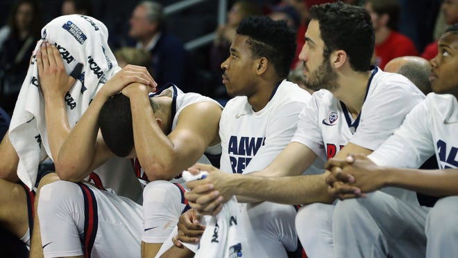 The Arizona Wildcats bench reacts late in the second half during a 65-55 loss to Wichita State in first round of the NCAA Tournament.