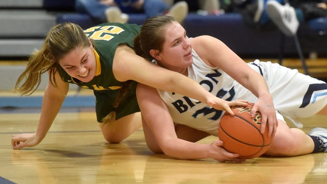 Great Falls High freshman Morgan Sunchild (33) battles for a loose ball against senior Kayci Edwards (22) of C.M. Russell during one of the crosstown basketball games last season at Bill Swarthout Fieldhouse.