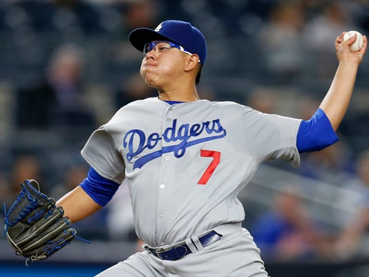 """CORRECTS TO NEW YORK YANKEES INSTEAD OF NEW YORK METS IN FIRST SENTENCE FILE - This Sept. 13, 2016 file photo shows Los Angeles Dodgers' starting pitcher Julio Urias delivering during the first inning of a baseball game against the New York Yankees in New York. Urias is scheduled to start for the Dodgers in Game 4 of the NL Championship Series against the Chicago Cubs. Manager Dave Roberts said Monday, oct. 17, 2016 the 20-year-old rookie from Mexico will open Wednesday, followed by Kenta Maeda in Game 5 on Thursday """"as it stands now.'' (AP Photo/Kathy Willens, file)"""