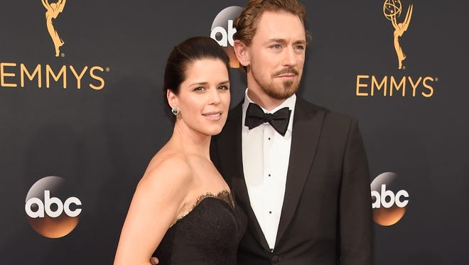 Neve Campbell (L) and JJ Feild attend the 68th Primetime Emmy Awards in 2016.