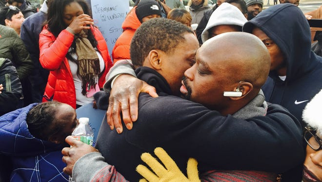 Jermaine Wright, a former death row inmate who was freed last year, hugs friends and family goodbye before turning himself in to go back to prison in January. He is now to be retried in a 1991 slaying.