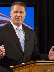 Democrat Bruce Braley makes opening remarks in his