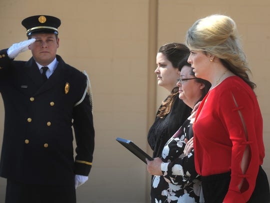 The wife and daughters of police officer David Varner
