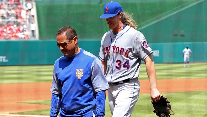 Noah Syndergaard was removed from Sunday's game in the second inning with an injury.