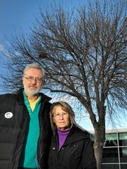 Jerry and Patty Wetterling stand next to a tree planted