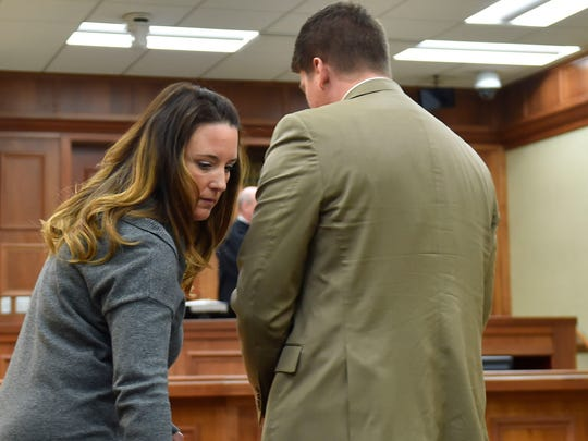 Former Door County Humane Society executive director Carrie Counihan leaves Door County Circuit Court after being sentenced to nine months in jail Friday. At right is her lawyer Eric R. Wimberger of Green Bay.