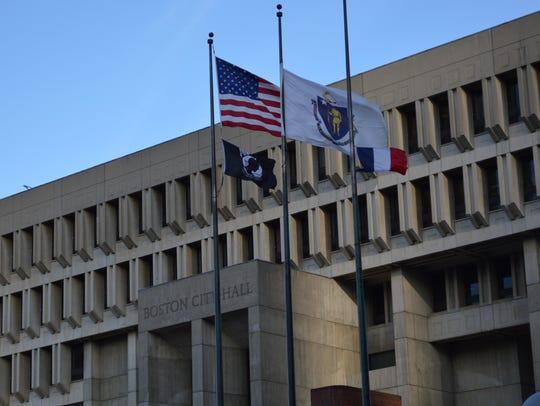 French flag raised next to American flag outside Boston