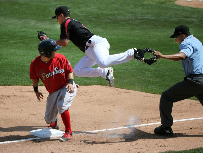 Red Wings third baseman Tommy Field flies over the