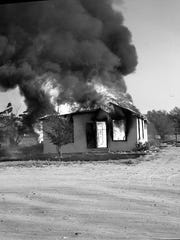 A house fire on Section 14 is seen on May 21, 1964.