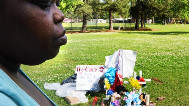 Kinyda Broadway, the mother of Keandre Broadway, 13, stands in front of his memorial where he was shot in Hattie Perry Park.