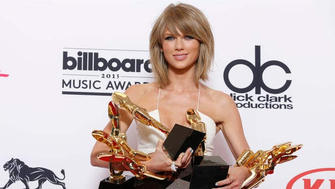 Taylor Swift with awards at Billboard Music Awards in Las Vegas, in May 2015.