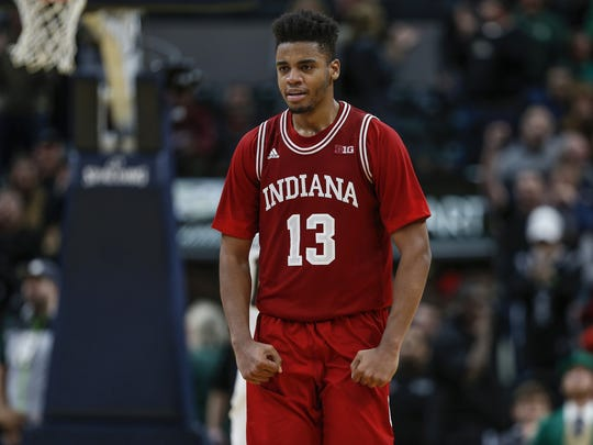 Indiana Hoosiers forward Juwan Morgan (13) celebrates after defeating the Notre Dame Fighting Irish 80-77 during the Crossroads Classic at Bankers Life Fieldhouse in Indianapolis on Saturday, Dec. 16, 2017.